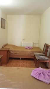 Кровать или кровати в номере Гостевой Дом Фламинго