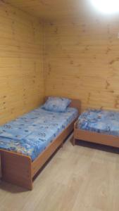 Кровать или кровати в номере Гостевой дом Камелия