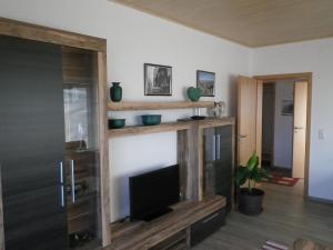 TV/Unterhaltungsangebot in der Unterkunft CMVA-Ferienwohnung Haus Gutleut