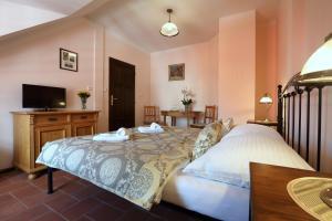 Postel nebo postele na pokoji v ubytování Penzion Na 15. Poledníku