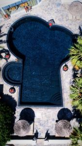 A view of the pool at Villa Manos Hotel or nearby