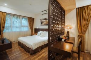 A bed or beds in a room at Thang Long Opera Hotel