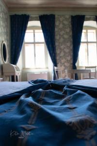 Postel nebo postele na pokoji v ubytování Zámek Nový Hrad