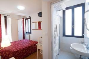 Um banheiro em Albergo ai Tolentini
