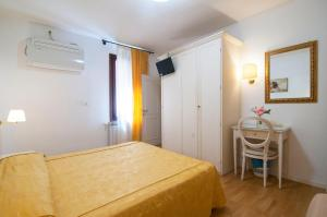 Cama ou camas em um quarto em Albergo ai Tolentini
