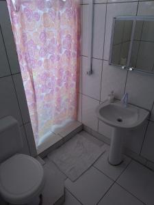 Ванная комната в POA Central - Acomodações econômicas
