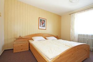 Ein Bett oder Betten in einem Zimmer der Unterkunft ferienwohnungen-bendler
