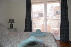Uma cama ou camas num quarto em Petunia - Guest House