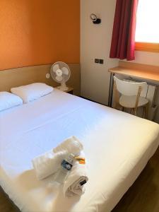Un ou plusieurs lits dans un hébergement de l'établissement Premiere Classe Annecy Cran-Gevrier
