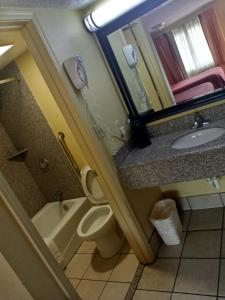 A bathroom at Super 8 by Wyndham Tulsa