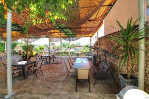 Ресторант или друго място за хранене в Хотел комплекс Антик