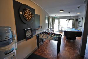 A kitchen or kitchenette at Harcourt Hotel