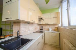 A kitchen or kitchenette at Жилой комплекс Айгерим
