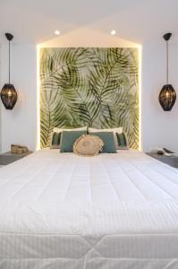 A bed or beds in a room at Anatoli Hotel
