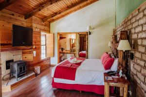 A television and/or entertainment center at The Lodge At Creel Eco - Hotel & Spa