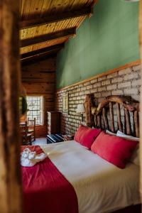 A bed or beds in a room at The Lodge At Creel Eco - Hotel & Spa