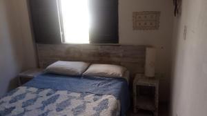 A bed or beds in a room at Pousada A Vida é Bela
