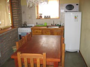 A kitchen or kitchenette at Cabañas Lorien