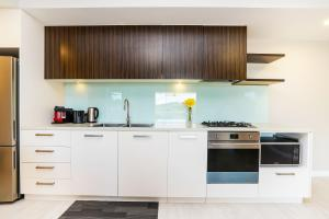 A kitchen or kitchenette at Darwin Waterfront Luxury Suites