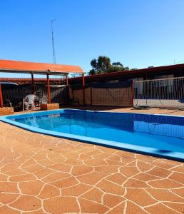 The swimming pool at or near Ardeanal Motel