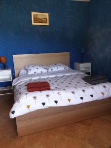 Un ou plusieurs lits dans un hébergement de l'établissement The Goldy's Farm - Ferme de la Combe