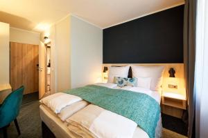 A bed or beds in a room at Stadthotel Borken
