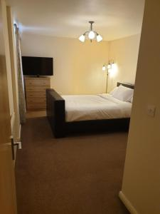 A bed or beds in a room at 206 Berberis house