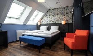 A bed or beds in a room at Thon Hotel Tromsø