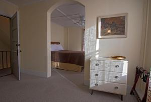 A bed or beds in a room at The Woodbine Inn