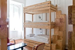 A bunk bed or bunk beds in a room at The Independente Hostel & Suites