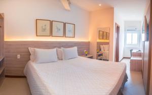 Cama ou camas em um quarto em Malibu Plaza Hotel