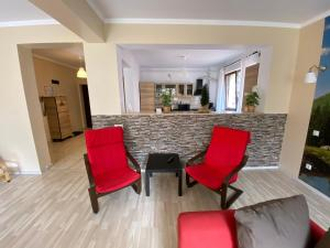 O zonă de relaxare la Apartament Holiday Busteni