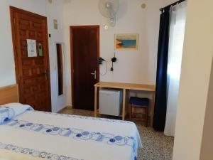 Cama o camas de una habitación en Hostal Pepe