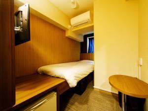 Cama o camas de una habitación en Super Hotel Lohas Ikebukuro-Eki Kitaguchi