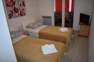 A bed or beds in a room at Korcula Apartments Iliskovic