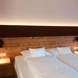 A bed or beds in a room at ApartHotel Rose