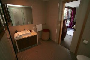 A bathroom at 6/21-25 Fletcher Street - A Seventh Heaven