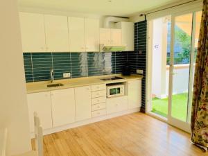 A kitchen or kitchenette at Apartaments Sa Torre