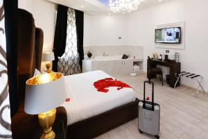 A bed or beds in a room at Escape Luxury Suite