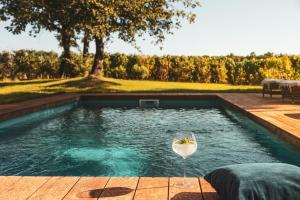The swimming pool at or near Meneghetti Wine Hotel and Winery - Relais & Chateaux