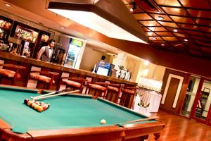 A pool table at Grand Oriental Hotel