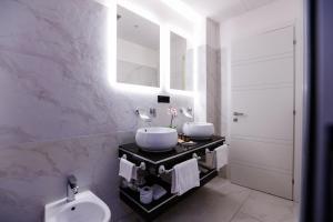 A bathroom at Escape Luxury Suite