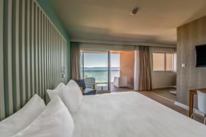 A bed or beds in a room at Radisson Blu Resort & Spa, Ajaccio Bay