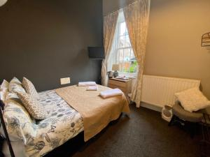 A bed or beds in a room at 16 Pilrig Guest House