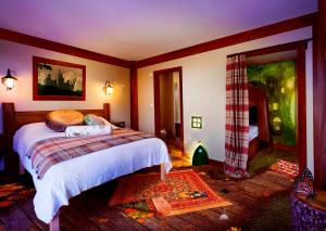 A bed or beds in a room at Alton Towers Resort