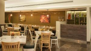 A restaurant or other place to eat at Stanza Hotel