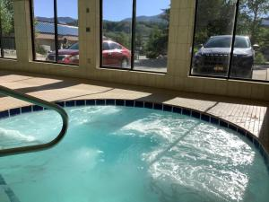 The swimming pool at or near Luxury Inn & Suites