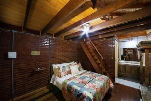 A bed or beds in a room at Estalagem Villaggio Alpino