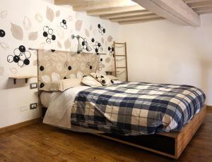 Cama o camas de una habitación en A Casa Di Olga