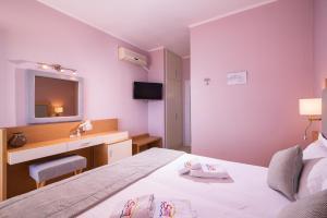 Ένα ή περισσότερα κρεβάτια σε δωμάτιο στο Sunny Hotel Thassos